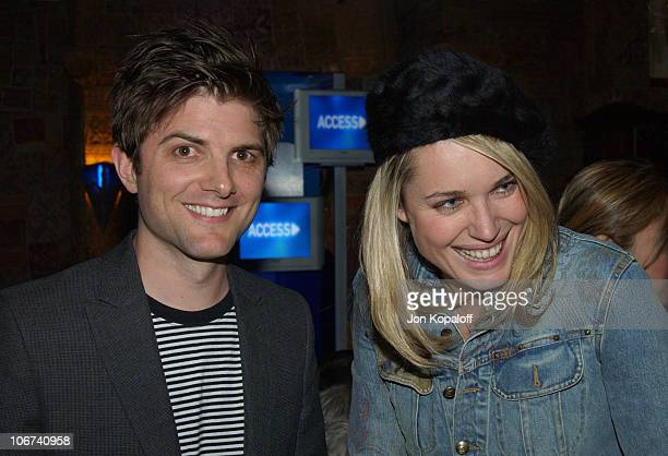 Adam Scott and Rebecca RomijnStamos enjoy a performance by Elvis Costello and The Imposters at the House of Blues for a sold out Grammy week concert...