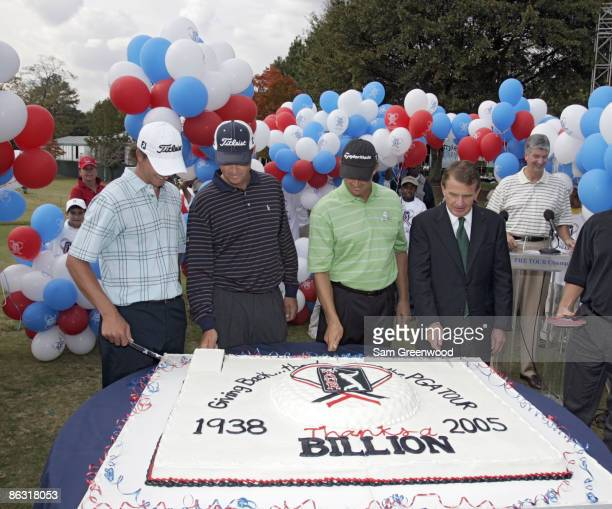 Adam Scott Davis Love III Retief Goosen and PGA Tour Commissioner Tim Finchem cut the cake during the PGA Tour Thanks a Billion celebration at the...