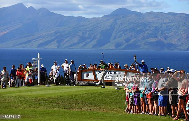 Adam Scott hits a tee shot on the 14th hole during round three of the Hyundai Tournament of Champions at the Plantation Course at Kapalua Golf Club...