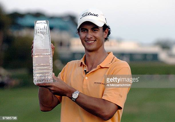 Adam Scott hoists the winner's trophy after finalround play at the PGA Tour's Players Championship March 28 2004