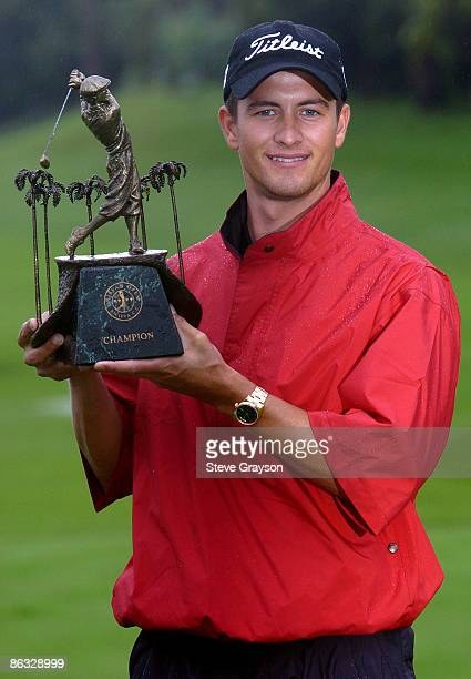 Adam Scott holds the winner's trophy after defeating Chad Campbell in a one hole sudden death playoff in the 2005 Nissan Open Presented By...
