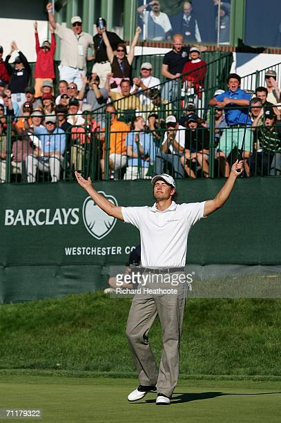 Adam Scott of Austrailia reacts as he sinks an eagle putt on the 18th green during the final round of the Barclays Classic at the Westchester Country...