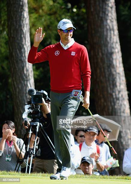 Adam Scott of Australia acknowledes the crowd after a birdie on the seventh green during the first round of the Japan Open at Chiba Country Club on...