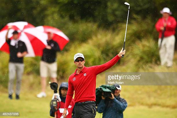 Adam Scott of Australia acknowledges the crowd after chippin in on the Third hole during day two of the Australian Open at Royal Sydney Golf Club on...