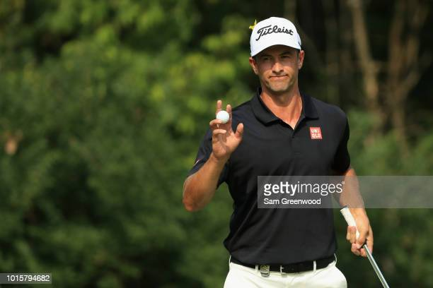Adam Scott of Australia acknowledges the crowd after making a putt for birdie on the 13th green during the final round of the 2018 PGA Championship...