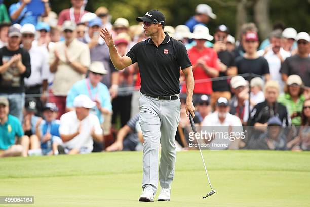 Adam Scott of Australia acknowledges the crowd after putting on the 2nd hole during day four of the Australian Open at The Australian Golf Club on...