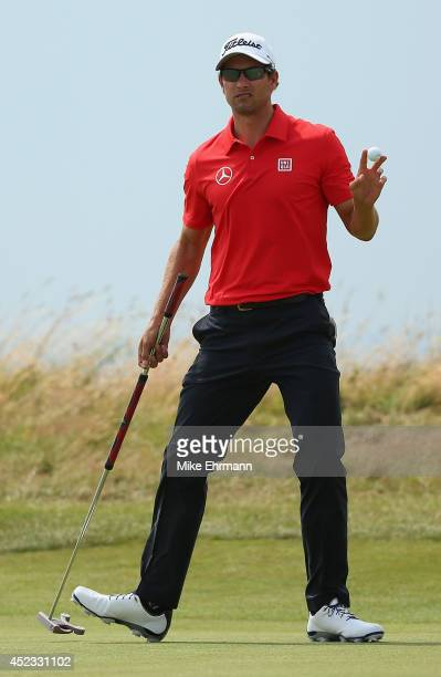 Adam Scott of Australia acknowledges the crowd on the 14th hole during the second round of The 143rd Open Championship at Royal Liverpool on July 18...