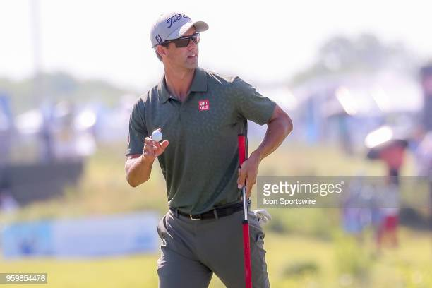 Adam Scott of Australia acknowledges the gallery after making birdie on during the second round of the 50th anniversary AT&T Byron Nelson on May 18,...