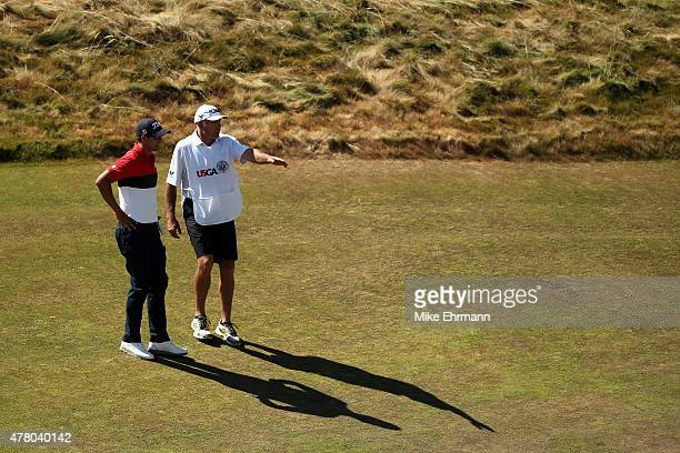 Adam Scott of Australia and caddie Steve Williams talk on the 12th green during the final round of the 115th US Open Championship at Chambers Bay on...