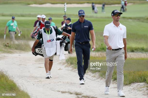 Adam Scott of Australia and Henrik Stenson of Sweden walk to fifth hole during the first round of the 2018 US Open at Shinnecock Hills Golf Club on...
