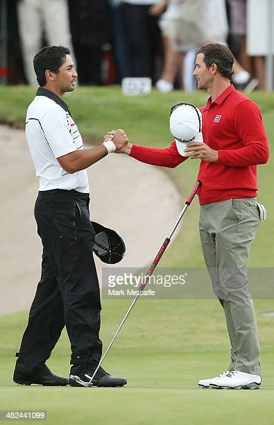 Adam Scott of Australia and Jason Day of Australia shake hands at the end of their rounds during day two of the Australian Open at Royal Sydney Golf...