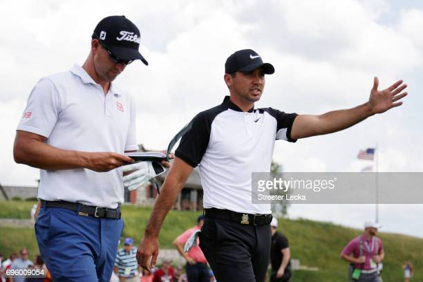 Adam Scott of Australia and Jason Day of Australia walk across the course during a practice round prior to the 2017 US Open at Erin Hills on June 14...
