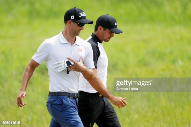 Adam Scott of Australia and Jason Day of Australia walk across the course during a practice round prior to the 2017 U.S. Open at Erin Hills on June...