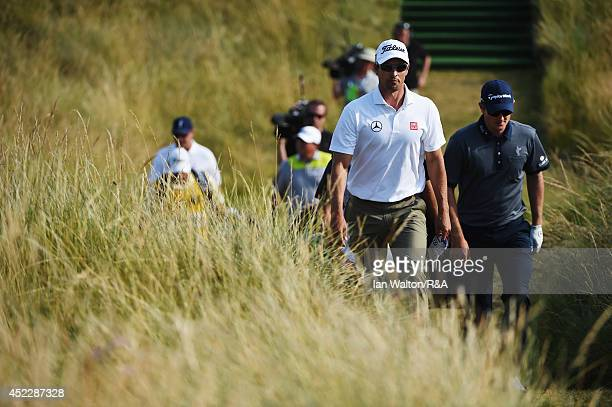 Adam Scott of Australia and Justin Rose of England walk off the 14th tee during the first round of The 143rd Open Championship at Royal Liverpool on...