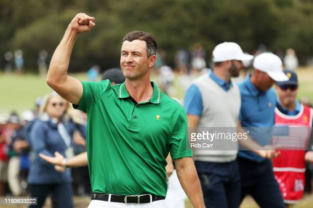 Adam Scott of Australia and the International team celebrates after he and Louis Oosthuizen of South Africa and the International team defeated...