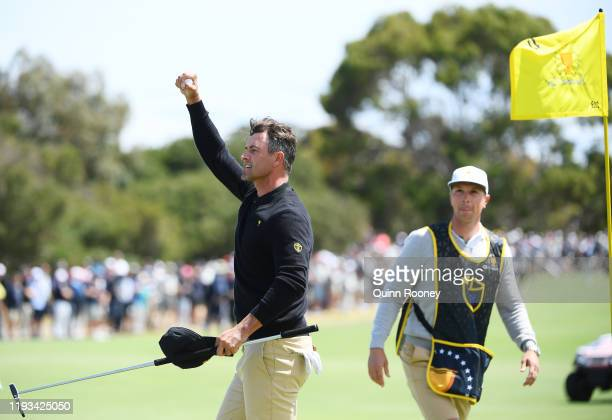 Adam Scott of Australia and the International team celebrates on the 17th green after he and ByeongHun An of South Korea and the International team...