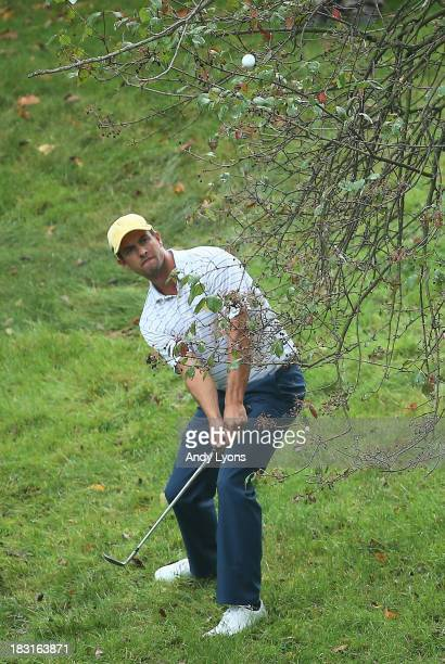 Adam Scott of Australia and the International Team plays a shot from the rough on the11th hole during the Day Three Four-ball Matches at the...