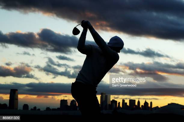 Adam Scott of Australia and the International Team practices on the range prior to Saturday foursome matches of the Presidents Cup at Liberty...