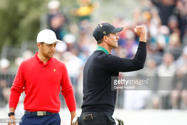Adam Scott of Australia and the International team reacts as Xander Schauffele of the United States team looks on during Sunday Singles matches on...
