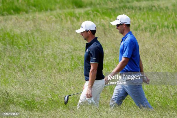 Adam Scott of Australia and Wade Ormsby of Australia walk from the 17th tee during a practice round prior to the 2017 US Open at Erin Hills on June...