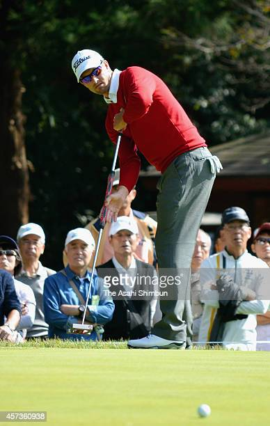 Adam Scott of Australia attempts a birdie putt on the seventh green during the first round of the Japan Open at Chiba Country Club on October 16 2014...
