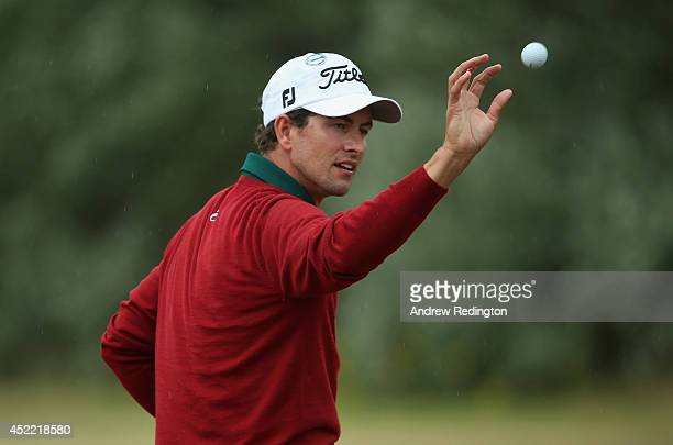 Adam Scott of Australia catches a ball on the range during a practice round prior to the start of The 143rd Open Championship at Royal Liverpool on...