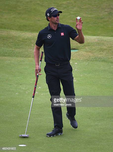 Adam Scott of Australia celebrates a birdie on the 18th hole during the final round of The 143rd Open Championship at Royal Liverpool on July 20 2014...