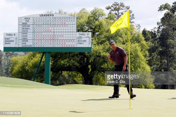 Adam Scott of Australia celebrates a putt for birdie on the 18th green during the first round of the Masters at Augusta National Golf Club on April...