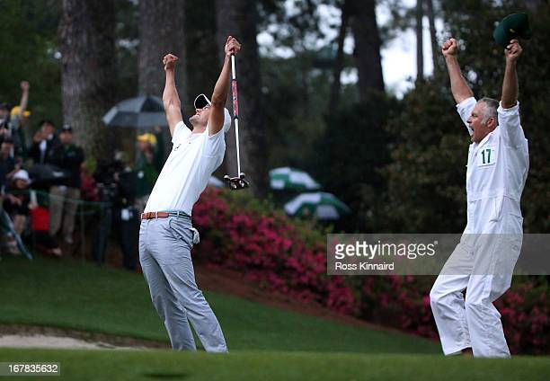 Adam Scott of Australia celebrates after his birdie putt on the second play off hole which saw him win the Green Jacket during the final round of the...