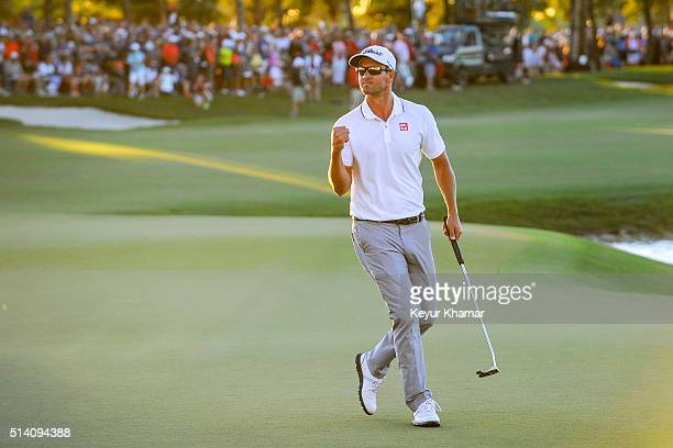 Adam Scott of Australia celebrates after his one stroke victory on the 18th hole green during the final round of the World Golf ChampionshipsCadillac...