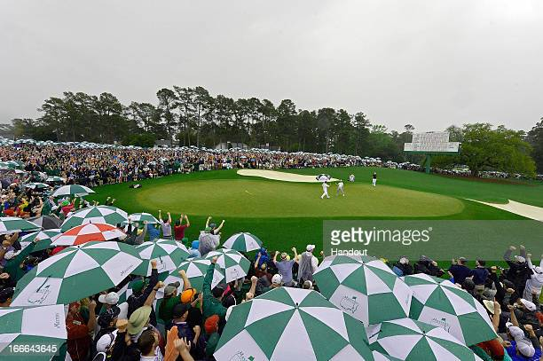 Adam Scott of Australia celebrates after making a birdie on the 18th hole in this handout image provided by the Augusta National Golf Club, during...