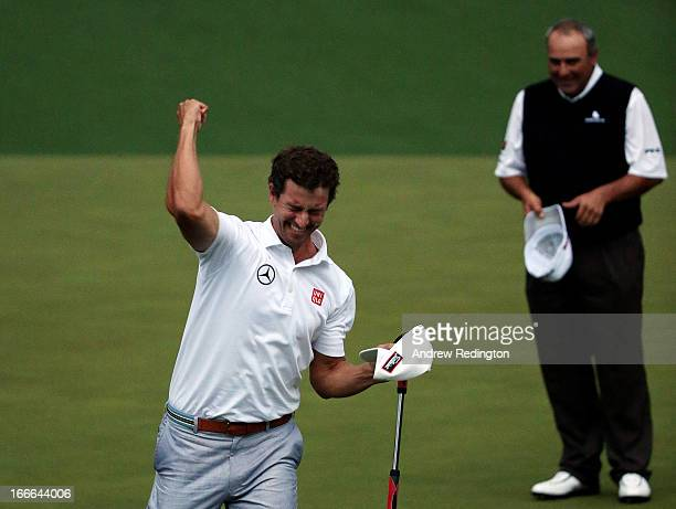 Adam Scott of Australia celebrates after Scott makes a birdie putt on the second sudden death playoff hole to defeat Angel Cabrera of Argentina to...