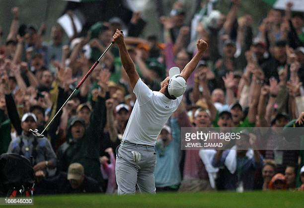Adam Scott of Australia celebrates his win on the 10th hole during a playoff with Angel Cabrera of Argentina at the fourth round of the 77th Masters...