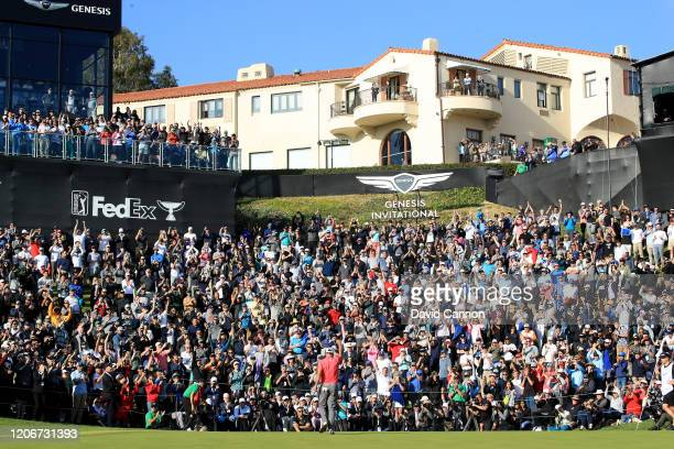 Adam Scott of Australia celebrates holing the winning putt on the par 4 18th hole during the final round of the Genesis Invitational at The Riviera...