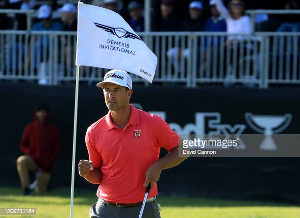 Adam Scott of Australia celebrates making a crucial birdie putt on the par 5 17th hole during the final round of the Genesis Invitational at The...