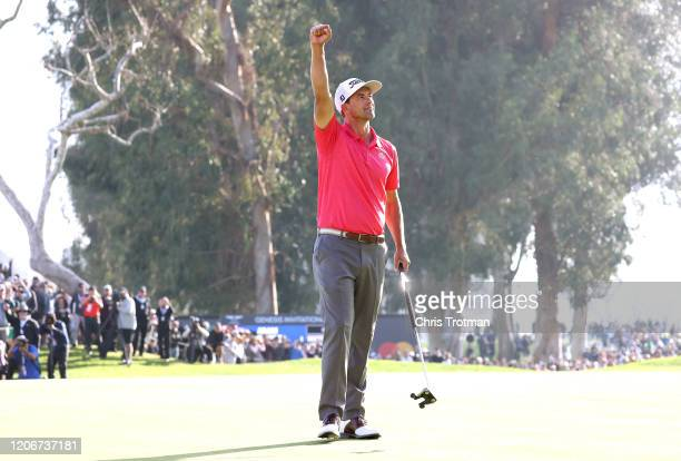 Adam Scott of Australia celebrates making a par on the 18th green to win the Genesis Invitational on February 16 2020 in Pacific Palisades California