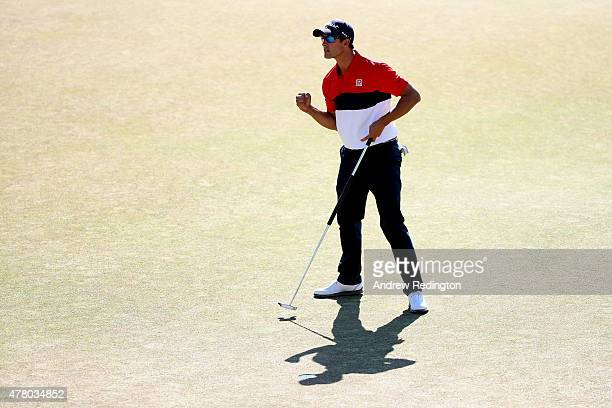 Adam Scott of Australia celebrates on the 18th green after a sixunder par 64 during the final round of the 115th US Open Championship at Chambers Bay...