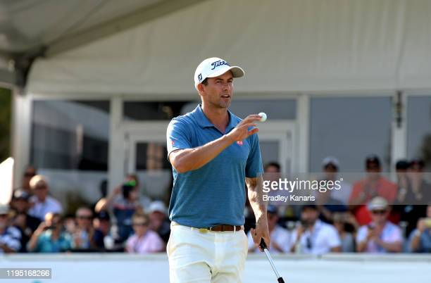 Adam Scott of Australia celebrates on the 18th hole after taking the lead during day three of the PGA Championships at RACV Royal Pines on December...