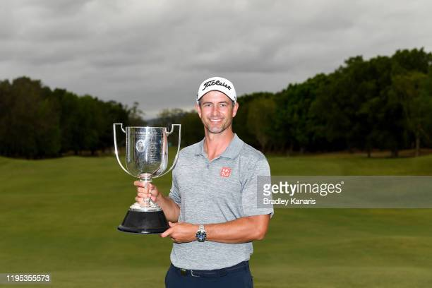 Adam Scott of Australia celebrates victory as he holds up the Kirkwood Cup during day four of the PGA Championships at RACV Royal Pines on December...