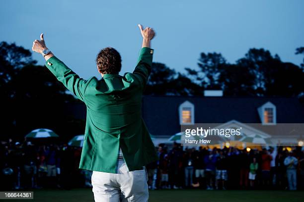 Adam Scott of Australia celebrates while wearing his green jacket after winning the 2013 Masters Tournament at Augusta National Golf Club on April 14...