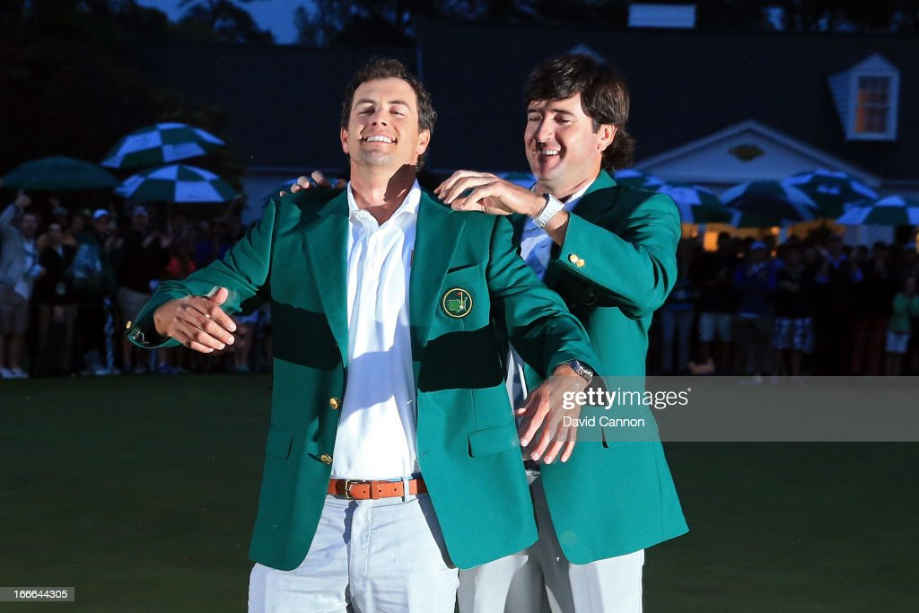Adam Scott of Australia celebrates with 2012 Masters champion Bubba Watson after Scott wins the 2013 Masters Tournament at Augusta National Golf Club on April 14, 2013 in Augusta, Georgia.