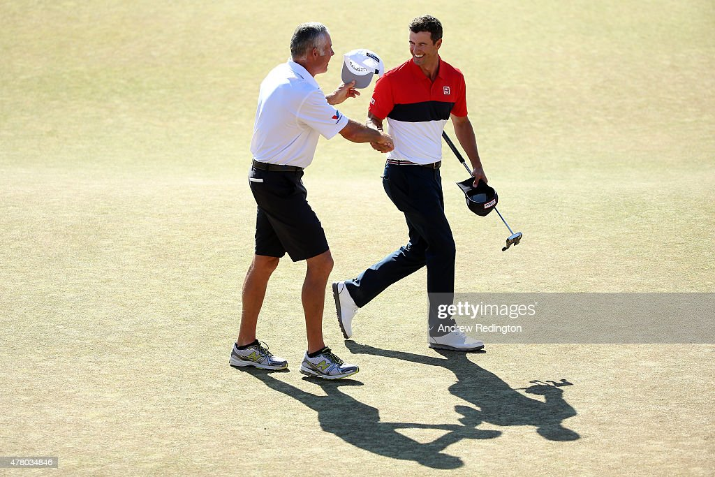 Adam Scott of Australia celebrates with his caddie Steve Williams on the 18th green after a six-under par 64 during the final round of the 115th U.S. Open Championship at Chambers Bay on June 21, 2015 in University Place, Washington.