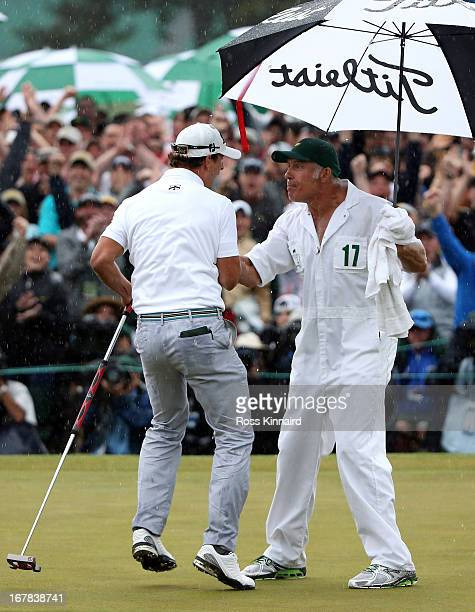 Adam Scott of Australia celebrates with his caddie Steve Williams after his birdie on the 18th green which got him into a play off during the final...