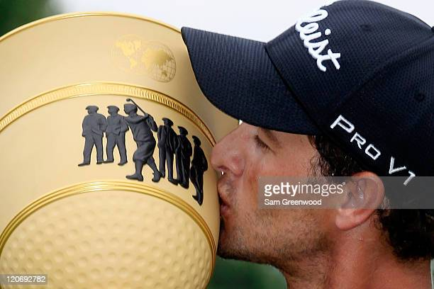 Adam Scott of Australia celebrates with the Gary Player Cup trophy during the trophy presentation after his fourstroke victory during the final round...