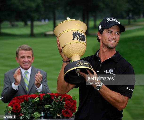 Adam Scott of Australia celebrates with the Gary Player trophy during the final round of the World Golf Championships-Bridgestone Invitational at...