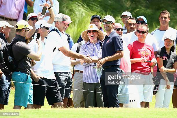 Adam Scott of Australia gives his glove to a member of the crowd on the 9th during day two of the Australian Open at The Australian Golf Course on...
