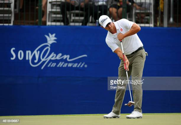 Adam Scott of Australia hits a putt on the 18th green during the third round of the Sony Open in Hawaii at Waialae Country Club on January 11 2014 in...