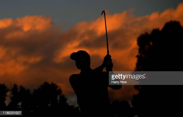 Adam Scott of Australia hits a second shot on the 2nd hole green during the third round of the Genesis Open at Riviera Country Club on February 16...