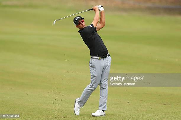 Adam Scott of Australia hits a shot from the fairway during day one of the 2015 Australian Masters at Huntingdale Golf Course on November 19, 2015 in...