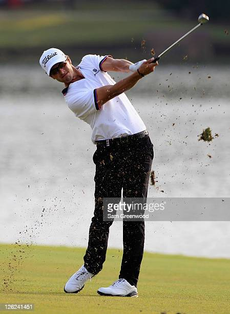 Adam Scott of Australia hits a shot to the 17th green during the second round of the TOUR Championship at East Lake Golf Club on September 23 2011 in...